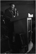 Martin Luther King, Jr., speaking to a crowd in a church building in Greenville, Alabama.