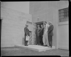 Warden John Gavin standing outside of a doorway with J. David White, George McGrath, Dr. Leon Shapiro, and Francis J. Ryrt