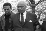 Andrew Young and Martin Luther King, Sr., at South View Cemetery during Martin Luther King, Jr.'s funeral.