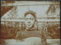 African-American girl in front of a picket fence