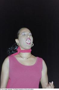 Sherine Bailey singing during Lift Up Jamaica performance Ashe Caribbean Dance
