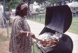 Joanette Jarman with barbecue ribs at the 1990 Alabama Folklife Festival in Birmingham, Alabama.