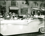 Members of the Order of the Eastern Star riding in convertible automobile