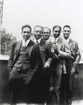 Author Langston Hughes [far left] with [left to right:] Charles S. Johnson; E. Franklin Frazier; Rudolph Fisher and Hubert T. Delaney, on the roof of 580 St. Nicholas Avenue, Harlem, on the occasion of a party in Hughes' honor, 1924
