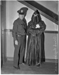 Police officer stands with R.F. McGarry, member of the Black Legion secret society, Los Angeles, 1936