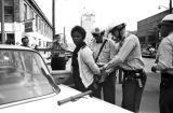 Police officers arresting Mattie Howard during the Children's Crusade in Birmingham, Alabama.