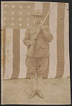 [Unidentified African American soldier in uniform and campaign hat with rifle in front of American flag]