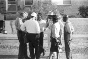Representative Alton Turner, James Kolb, and others, talking outside during a civil rights demonstration in Luverne, Alabama.