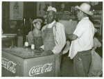 Mexican and negro cotton pickers inside plantation store, Knowlton Plantation, Perthshire, Miss. Delta. This transient labor is contracted for and brought in trucks from Texas each season. October 1939
