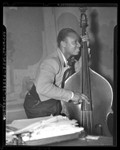 Negro Nite Life on Central Avenue...Series, African American bass player in Los Angeles, Calif., 1938