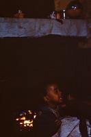 Child near a fireplace