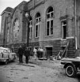 Thumbnail for Damaged car and debris beside 16th Street Baptist Church in Birmingham, Alabama, after the building was bombed.