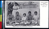 Young girls eating dinner at school, Pālayankottai, India, ca.1900-1920