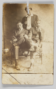 Photographic postcard of three unidentified men