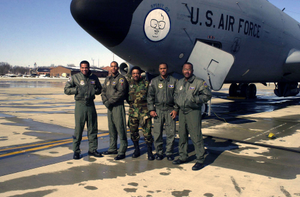 This is the first African-American flight crew from the 126th Air Refueling Wing, Scott AFB, Illinois, to fly a mission together. This Illinois Air National Guard (IANG) crew flew a KC-135E Stratotanker (Spirit of Harry Caray) to transport IANG members to Savannah, Georgia. From left to right: Captain (CAPT) Ralph Delatour, USAF, Co-Pilot, CAPT Jerome Cole, USAF, Pilot, SENIOR MASTER Sergeant (SMSGT) Maurice Bridges, USAF, Crewchief, STAFF Sergeant (SSGT) Arie Latimer, USAF, Boom Operator, and MASTER Sergeant (MSGT) Steve Butler, USAF, Boom Operator