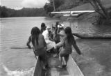 Peru, Harriet Platt, Roberto Moreno and Aguaruna Indians canoeing on Nieva River