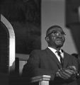 Elderly man seated on the stage behind the podium at St. Paul AME Church in Birmingham, Alabama, probably listening to Martin Luther King, Jr., speak.