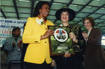 Yvonne Brathwaite Burke and Dorothy Donegan Hold Plaque