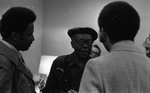Jesse Fuller speaking with tv host and newsman Ray Taliaferro (right) and unidentified man after his concert at the Oakland Museum