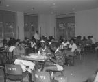 Students eating and working in a food court at Tuskegee Institute in Tuskegee, Alabama.