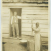 Black woman milling rice, Oakley, South Carolina