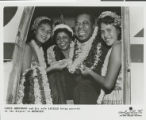 Photograph of Louis Armstrong and his wife Lucille greeted at the airport in Honolulu, no date