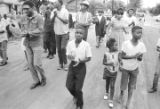 Richard Boone and others, marching through a neighborhood in Montgomery, Alabama, during a civil rights demonstration.