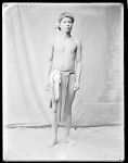 Dakota youth in loin cloth with bag at side