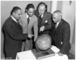 (Left to Right): Charles M. Thompson, Chairman of the World Service Committee, Wabash Avenue YMCA, Chicago, Illinois; Lawrence Burr; Grover Little; O. O. Morris, Executive Secretary of Wabash Avenue YMCA.