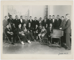 Dean Dixon, seated fifth from left, in a group portrait with the symphony orchestra that he organized, at the Harlem Y.M.C.A., New York City