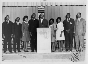 W.K. Alston and students at a function