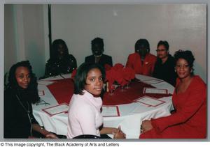 Guests seated at Christmas Kwanzaa soiree Christmas/Kwanzaa Soiree