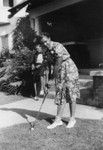 Woman practicing golf stroke