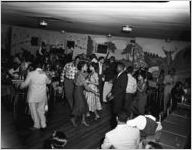 African-Americans on dance-floor of 180 Club, Atlanta, Georgia. Segregated party sponsored by Davison-Paxon Company, October 1954