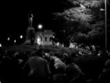 Crowd seated in front of the Confederate monument in Tuskegee, Alabama, during a student demonstration to protest the murder of Samuel L. Younge, a civil rights worker.
