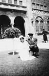 Couple in front of school