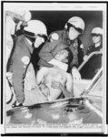 Los Angeles police hustle rioter into car