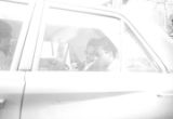 Rap Brown and Stokely Carmichael sitting in the backseat of a car after Carmichael's release from prison in Prattville, Alabama.
