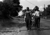 Edward Rudolph leading marchers down a road in Prattville, Alabama, during a demonstration sponsored by the Autauga County Improvement Association.