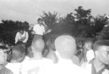 Richard Boone standing above a crowd, addressing participants in a civil rights demonstration in Montgomery, Alabama.