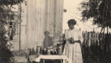 African American woman with jars of preserves in Madison County, Alabama.