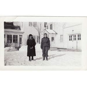 A housekeeper stands in the snowy yard of her employers.