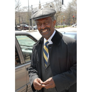 Reverend Michael E. Haynes stands beside his vehicle.