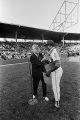 Mayor George Seibels presenting a medal to Hank Aaron before a game between the Atlanta Braves and the Baltimore Orioles at Rickwood Field in Birmingham, Alabama.