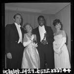 Sidney Poitier holding his Oscar poses with Gregory Peck , Annabella and Anne Bancroft backstage at 1964 Academy Awards