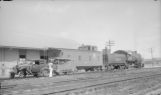 Waco, Beaumont, Trinity & Sabine Ry. motor car 1 and trailer 2 at Missouri Pacific depot, Trinity Tex. Missouri Pacific 2-8-0 1069 and caboose 218 behind.