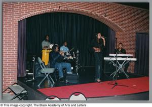 Rhea and band members onstage Hip-Hop Soul Cabaret
