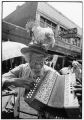 Thumbnail for Casey Jones, also known as Chicken Charlie, playing the accordion on Maxwell Street, east of Halsted Street