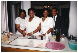Women and Men in Kitchen During Dorothy Washington Celebration San Antonio Chapter of Links Records