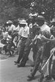"""Ralph Abernathy, Coretta Scott King, Martin Luther King, Jr., James Meredith, Stokely Carmichael, Floyd McKissick, and others, participating in the """"March Against Fear"""" through Mississippi."""